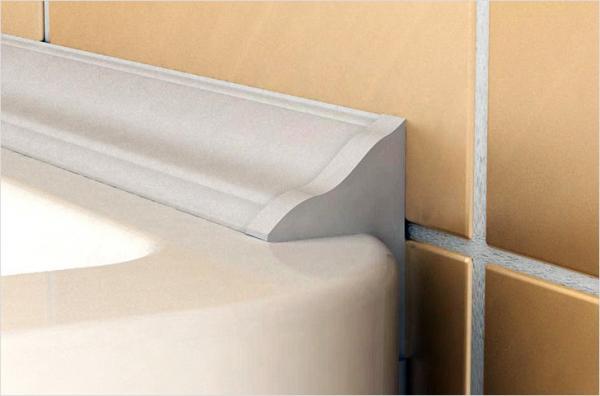 Как заделать шов между ванной и стеной?